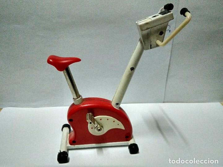 Bicicleta estática con mechero