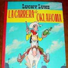 Tebeos: LUCKY LUKE LA CARRERA DE OKLAHOMA, TORAY - 2ª EDICIÓN 1969, ENCUADERNACIÓN EN TAPA DURA CON LOMO EN. Lote 3324257