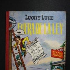 Tebeos: LUCKY LUKE FUERA DE LA LEY - TORAY - SEGUNDA EDICIÓN AÑO 1969 - TAPA DURA LOMO TELA. Lote 36440365