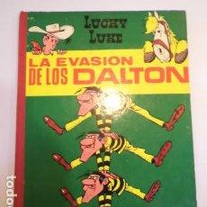 Tebeos: LUCKY LUKE - LA EVASION DE LOS DALTON - TORAY - PRIMERA EDICION 1964 - LOMO DE TELA. Lote 187525545