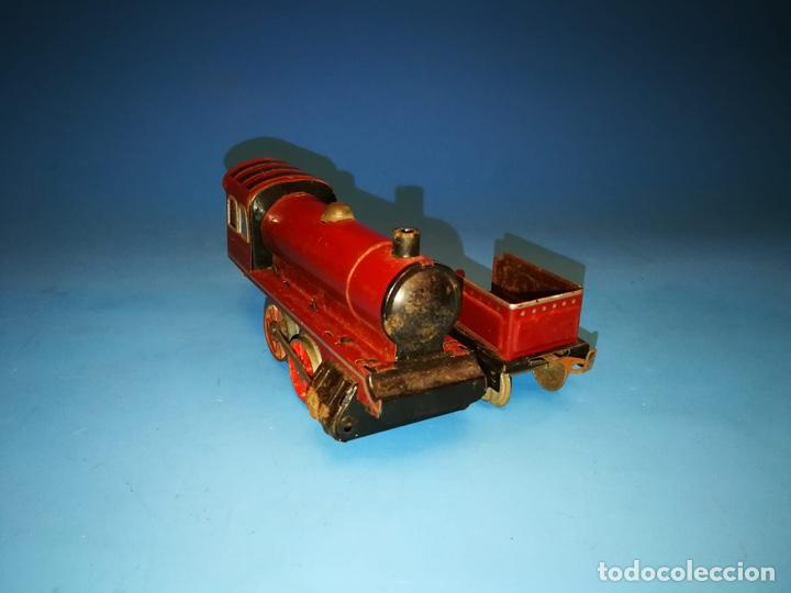 Trenes Escala: LOCOMOTORA PAYA ROJA A CUERDA ESCALA 0 RARISIMA - Foto 2 - 184648465