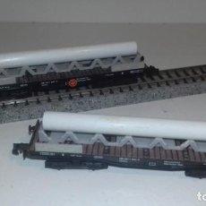 Trenes Escala: ARNOLD N 2 PLATAFORMAS 4 EJES CARGA TUBO -- L49-329 (CON COMPRA DE 5 LOTES O MAS, ENVÍO GRATIS). Lote 266548743