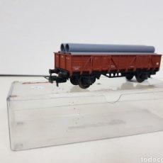 Trenes Escala: ELECTROTREN RENFE ESCALA H0 CORRIENTE CONTINUA VAGÓN DE MERCANCÍAS DE TUBOS DE 11 CENTÍMETROS. Lote 137631057