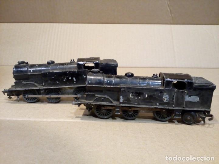TRI-ANG, 2 LOCOMOTORAS 69561 A CUERDA, AÑOS 60. (Juguetes - Trenes Escala H0 - Hornby H0)
