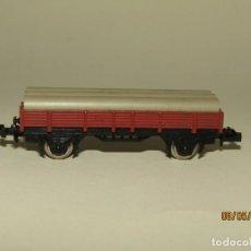 Trenes Escala: ANTIGUO VAGÓN BORDE BAJO 2 EJES CON TUBOS REF. 309 EN ESCALA *N* DE IBERTREN. Lote 163347330