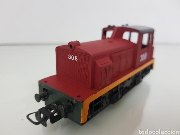 Trenes Escala: Locomotora Lima escala H0 roja con franja naranja 308 corriente continua con luz de 11,5 cm le falta - Foto 2 - 146382604