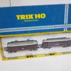 Trenes Escala: AUTOMOTOR TRIX H0 INTERNACIONAL 2470 GRANATE Y PLATEADO MEDIDA CONJUNTO 31 CM. Lote 133101427
