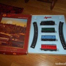 Trenes Escala: CAJA TREN FERROCARRIL A RESORTE DE JYESA AÑOS 70. Lote 164092274