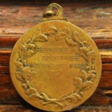 Trofeos y medallas: MEDALLA EN BRONE DESGASTADA POR SU ANTIGUEDAD: REUNIONS SPORTIVES INTERUNIVERSITARIES. Lote 30767674
