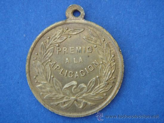 MEDALLA ANTIGUA-PREMIO A LA APLICACIÓN-. 2,45 CMS DE LONGUITUD. (Numismática - Medallería - Trofeos y Conmemorativas)