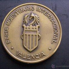 Trofeos y medallas: MEDALLA LXV ANIVERSARIO DE LA FERIA MUESTRARIO INTERNACIONAL DE VALENCIA. Lote 53853375