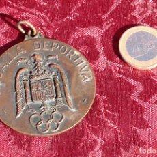Trofeos y medallas: VIEJA MEDALLA DEPORTIVA OLIMPICA EPOCA FRANCO - SEVILLA 1968. Lote 102651963