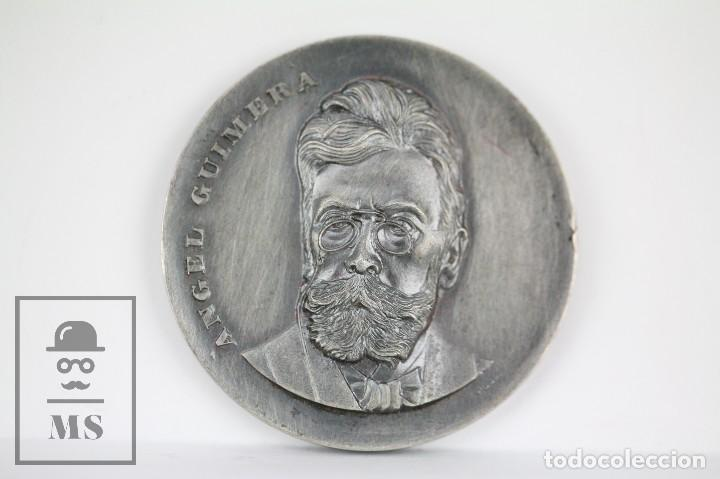 MEDALLA CONMEMORATIVA - ÁNGEL GUIMERÁ. V CONCURS LITERARI BIBIOBUS DE J. MONFORT. BARCELONA, 1975 (Numismática - Medallería - Trofeos y Conmemorativas)