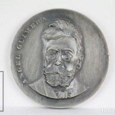 Trofeos y medallas: MEDALLA CONMEMORATIVA - ÁNGEL GUIMERÁ. V CONCURS LITERARI BIBIOBUS DE J. MONFORT. BARCELONA, 1975. Lote 109761139