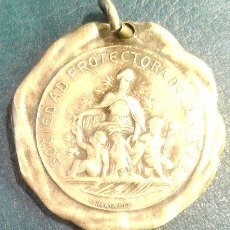 Trofeos y medallas: MEDALLA SOCIEDAD DE LA NINEZ ASILO HUERFANOS SANTA FE 1908. Lote 244395995