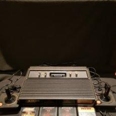 Jeux Vidéo et Consoles: CONSOLA ATARI 2600 + 2 MANDOS + 4 JUEGOS + CARGADOR. PARA REPARAR. Lote 242170190