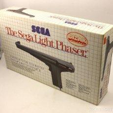 Videojuegos y Consolas: THE SEGA LIGHT PHASER - PISTOLA PARA MASTER SYSTEM - NUEVA A ESTRENAR - IMPECABLE. Lote 103784131
