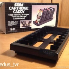 Videojuegos y Consolas: SEGA CARTRIDGE CADDY PARA JUEGOS DE MEGADRIVE MEGA DRIVE STAND SOPORTE CON CAJA NUBY OFICIAL NUEVO. Lote 118857250