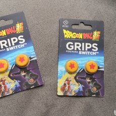 Videojuegos y Consolas Nintendo Switch: LOTE DE 2 ESTUCHES DE 2 GRIPS PARA NINTENDO SWITCH DE DRAGON BALL. Lote 182961855