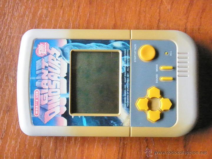 Videojuegos y Consolas: CONSOLA VINTAGE GIANT DINOSAURS MICRO GAMES OF AMERICA 1992 - Foto 2 - 44456366