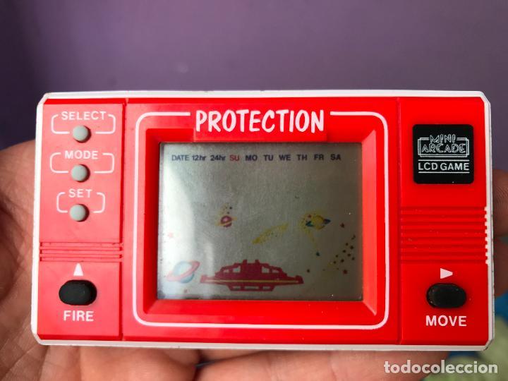MAQUINITA MINI ARCADE LCD GAME - PROTECTION - FUNCIONANDO CORRECTAMENTE (Juguetes - Videojuegos y Consolas - Otros descatalogados)