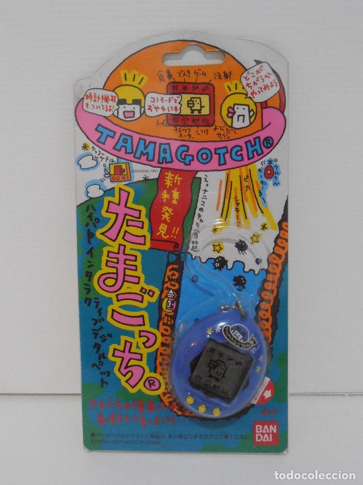 TAMAGOTCHI COLOR AZUL Y AMARILLO, BLISTER ORIGINAL BANDAI, IMPORTADO DE JAPON 1997 (Juguetes - Videojuegos y Consolas - Otros descatalogados)