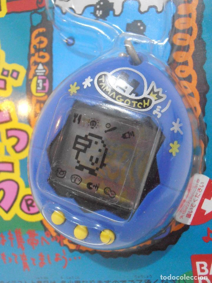 Videojuegos y Consolas: TAMAGOTCHI COLOR AZUL Y AMARILLO, BLISTER ORIGINAL BANDAI, IMPORTADO DE JAPON 1997 - Foto 2 - 173582657