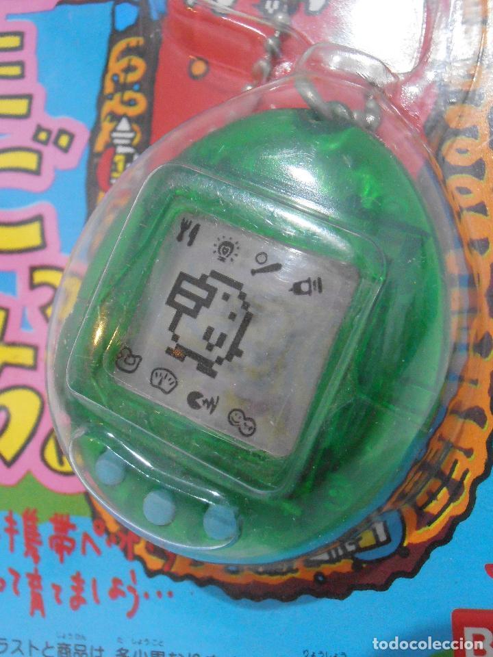 Videojuegos y Consolas: TAMAGOTCHI COLOR VERDE TRANSPARENTE, BLISTER ORIGINAL BANDAI, IMPORTADO DE JAPON 1997 - Foto 2 - 173582707