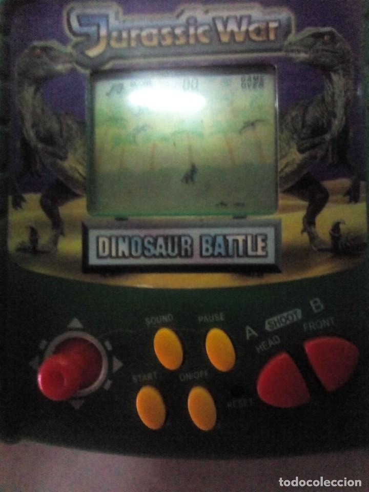 ANTIGUA CONSOLA JURASSIC WAR FUNCIONA (Juguetes - Videojuegos y Consolas - Otros descatalogados)