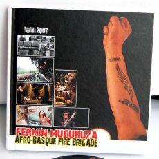 Vídeos y DVD Musicales: FERMIN MUGURUZA AFRO-BASQUE FIRE BRIGADE TOUR 2007 LIBRO Y DVD AFRO BASQUE 199 PAGINAS TAPAS DURAS. Lote 105983475