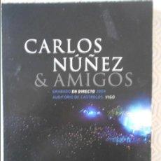 Vídeos y DVD Musicales: CARLOS NUÑEZ & AMIGOS. GRABADO EN DIRECTO 2004 AUDITORIO DE CASTRELOS VIGO. DVD Y CD. . Lote 140144710