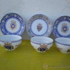 Vintage: 3 PLATOS Y TAZAS DE PORCELANA CON ESCUDOS. Lote 24563309
