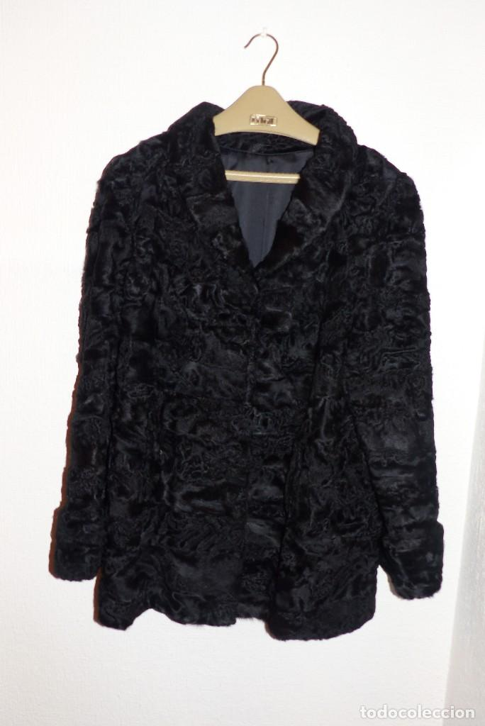 Compro abrigo de astracan