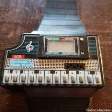Vintage - Antiguo reloj digital con piano. - 117341188